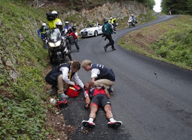Australia's Richie Porte gets medical assistance after crashing in the descent of the Mont du Chat pass during the ninth stage of the Tour de France cycling race.