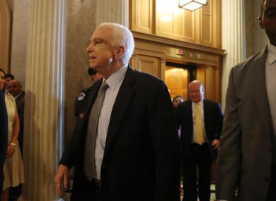 Senator John McCain arrives for the crucial healthcare vote.