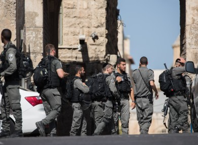 Israeli police guard the Lions Gate of Jerusalem's Old City near the site of the attack.