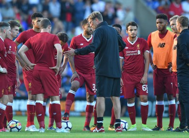 Klopp speaks to his players ahead of Wednesday's game against Tranmere.