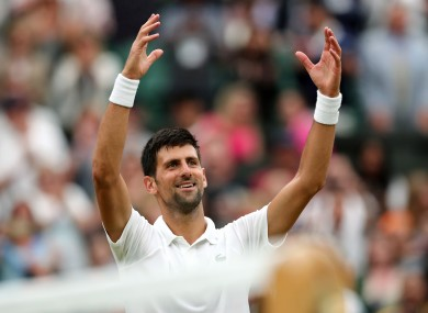 Djokovic celebrates victory on Centre Court.
