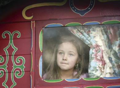 Kelsey Casey, aged 6 from Southhill, Limerick looks out from a decorated wagon window during a protest march.