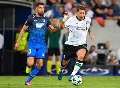 Hoffenheim's Kerem Demirbay with Liverpool forward Roberto Firmino during the first leg.