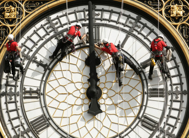File photo dated 18/08/14 of a specialist technical abseil team cleaning and inspecting one of the four faces of Big Ben.