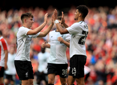 Dominic Solanke celebrates scoring his side's third goal with Ben Woodburn.