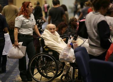 Evacuee Teddy Gifford, 90, waits for a medical evaluation at a Texas church.