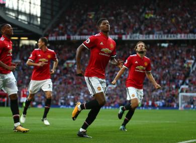 Rashford celebrates United's first goal.