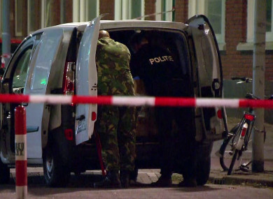 Police officers examine a van behind a cordoned-off area in Rotterdam last night.