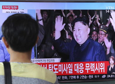 A man watches a TV news program showing an image of North Korean leader Kim Jong un during the North's latest test launch of an intercontinental ballistic missile, at Seoul Railway Station in Seoul, South Korea.