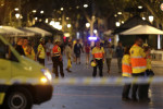 Emergency workers stand on a blocked street in Barcelona, Spain.