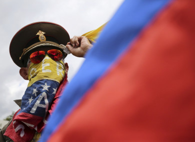 An anti-government demonstrator wearing a Russian military hat protests the government of Venezuela's President Nicolas Maduro in Caracas.