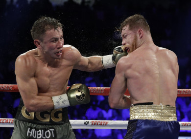 Gennady Golovkin, left, hits Canelo Alvarez during a middleweight title fight.