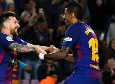 Lionel Messi celebrates with Paulinho.