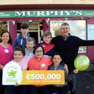 Mary Murphy (centre) with her family after selling a €500,000 Euromillions ticket on Bere Island, Cork.