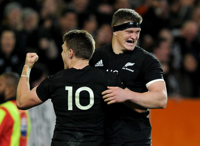 Beauden and his brother Scott Barrett celebrate a try against Australia.
