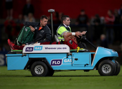 Goggin received treatment on the pitch before being carted off.