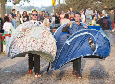 That's one way to bring your tent home.  (Glastonbury Festival 2017)