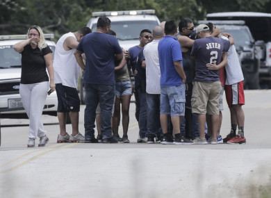Family members react as a van is pulled out of the Greens Bayou, Texas with the bodies of several family members