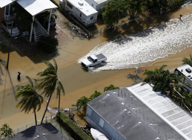 A truck drives through a flooded street in Key Largo, Florida in the wake of Hurricane Irma.