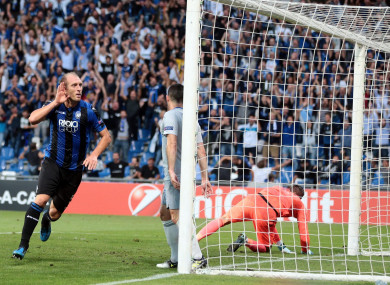 Atalanta's Andrea Masiello celebrates after scoring.