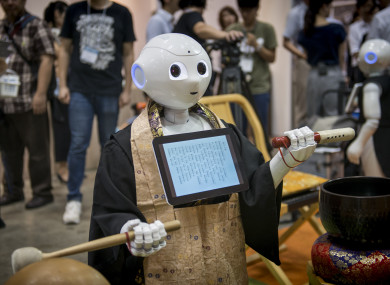 'Pepper' - the human-shaped robot while celebrating the Buddhist funeral rites to the Tokyo Int'l Funeral and Cemetery Show in Tokyo.