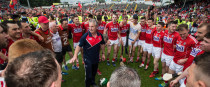 Cork Kieran Kingston with his players after the Munster final.