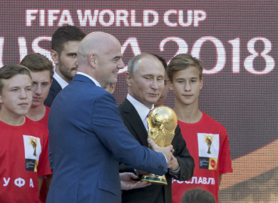 Fifa boss Gianni Infantino and Russian president Vladimir Putin with the World Cup trophy in Moscow last week.