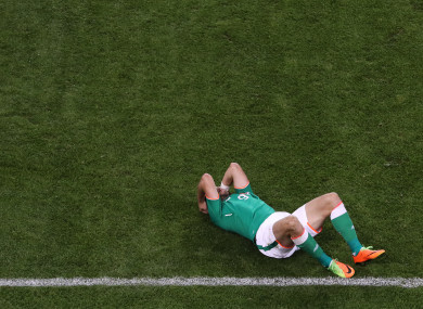 Ireland's Shane Long shows his disappointment after the game.