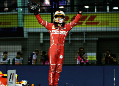 Sebastian Vettel celebrates his Singapore GP pole.