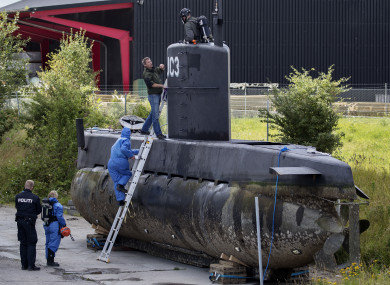 Police technicians board the amateur -built submarine UC3 Nautilus on a pier in Copenhagen harbour, Denmark, in August.