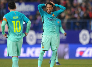 Neymar (R) reacts with Lionel Messi during a Barcelona match