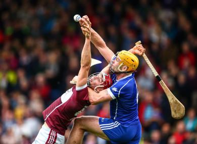 Borris-Ileigh's Niall Kenny and Padraic Maher of Thurles Sarsfields battle for a high ball.