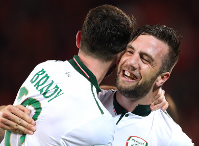 Ireland's Robbie Brady and Shane Duffy (right) celebrate after the game.