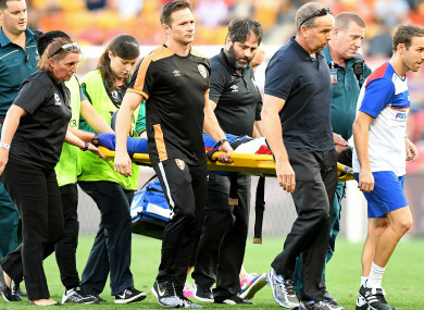Newcastle Jets midfielder Ronald Vargas is carried away on a stretcher.