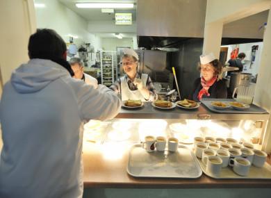 Volunteers hand out breakfast. (File, 2011)