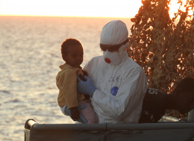 LE Roisin crew member with one of the 125 people it rescued off the coast of Tripoli last year.