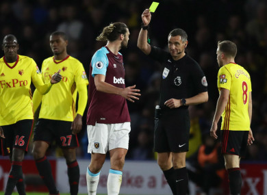 Andy Carroll is booked at Watford
