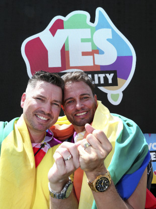 Scott D'Amico and Brad Harker celebrate after the same sex marriage vote result announcement in Queens Park, Brisbane Australia