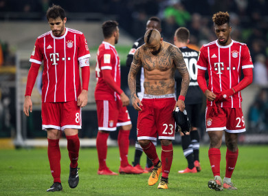 Bayern's Javi Martinez (L-R), Arturo Vidal and Kingsley Coman leave the pitch.