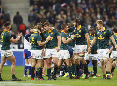 South Africa players celebrate their 18-17 victory over France.