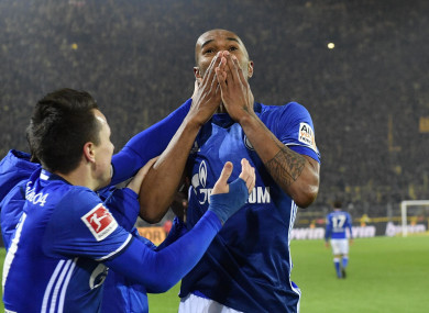 Defender Naldo celebrates scoring Schalke's fourth goal in stoppage time.