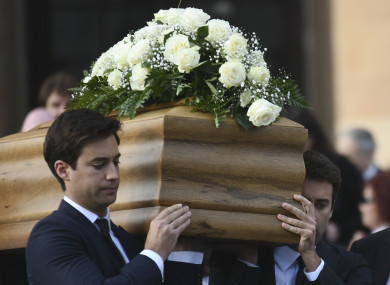 Galizia's sons, Paul and Matthew, carry the coffin during the funeral service