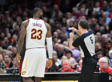 Referee Kane Fitzgerald ejects LeBron James during last night's game.