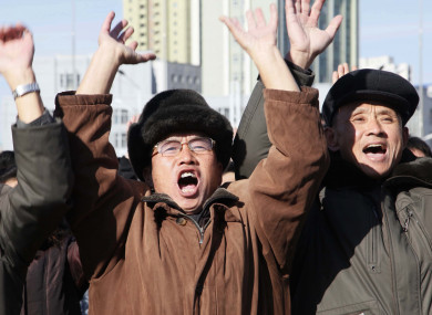 People cheer on the announcement of the successful test.