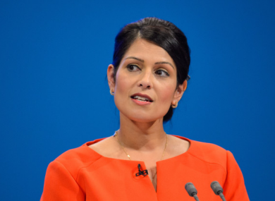Priti Patel gives a speech during the Conservative Party Conference.