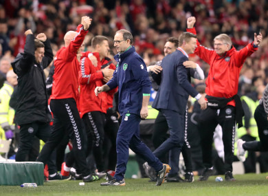 The Denmark sideline punch the air as O'Neill walks away.