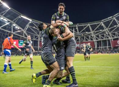 Ireland celebrate Jacob Stockdale's try.