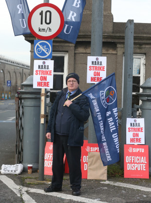 Irish Rail Revenue Protection Officer Harry Delaney from Dublin joins train drivers and rail workers picket outside Heuston Train Station in Dublin.