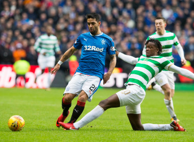 Celtic's Dedryck Boyata (right) and Rangers Daniel Candeias battle for the ball.