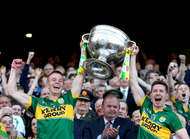 Fitzgerald lifts the Sam Maguire alongside Kieran O'Leary.